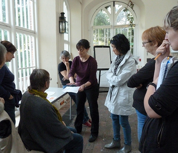 Students discuss experiments in the Orangery