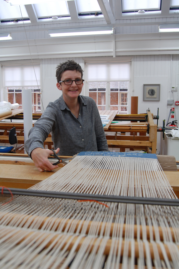 Caron Penney cutting off 'Work No. 1683' in West Dean Tapestry Studio, 2013